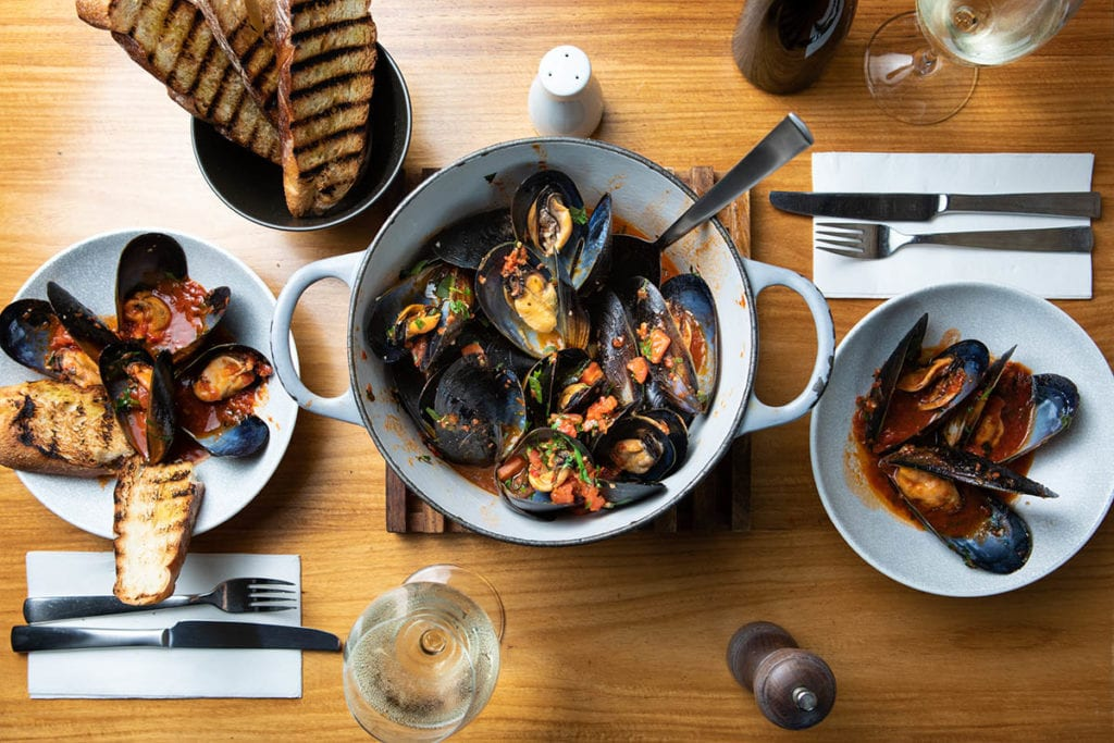 Mussels in a pot and bowls