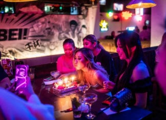 Woman blows out birthday candles