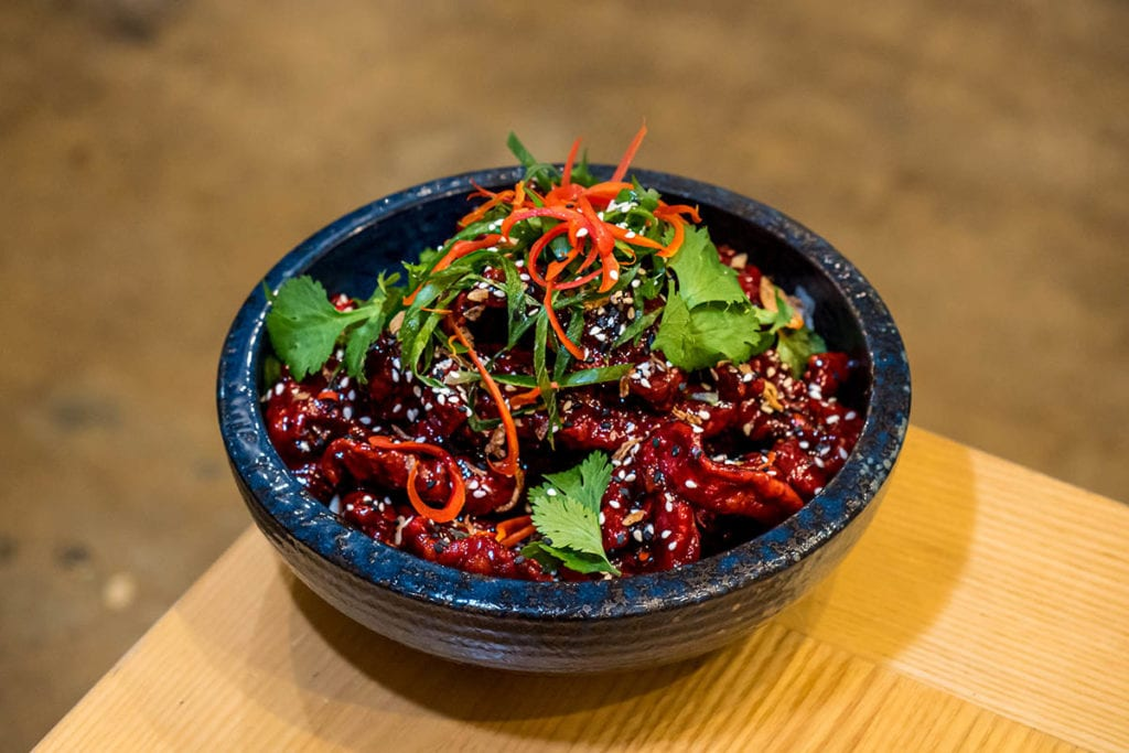 Bowl of sticky frid chicken