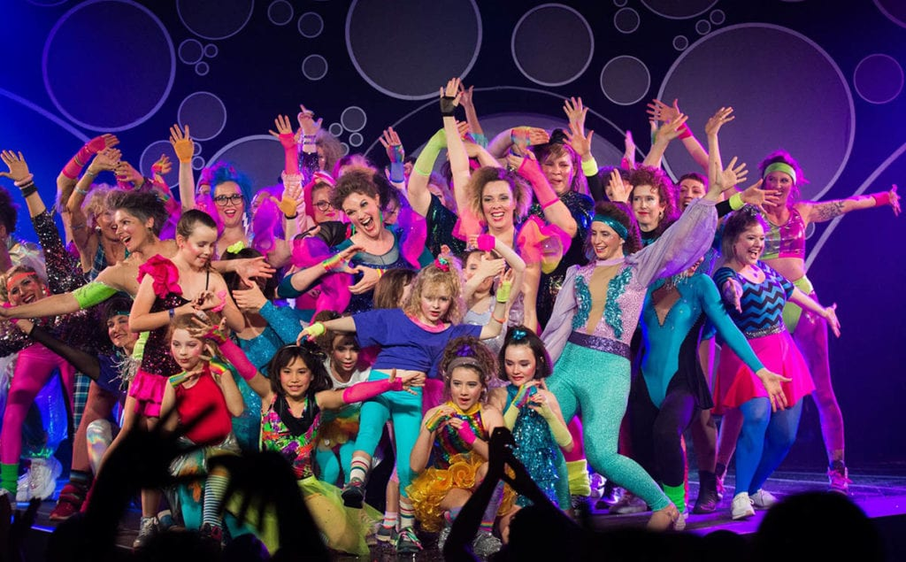 dancers in brightly coloured clothes