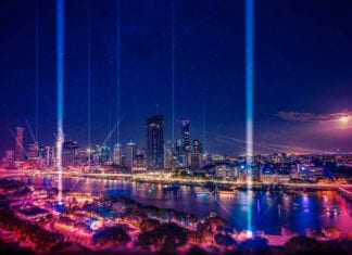 City scape lit up by lasers