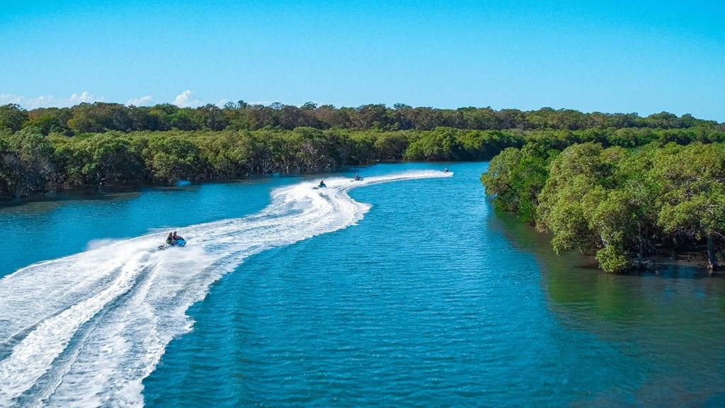 Jet ski group on waterway