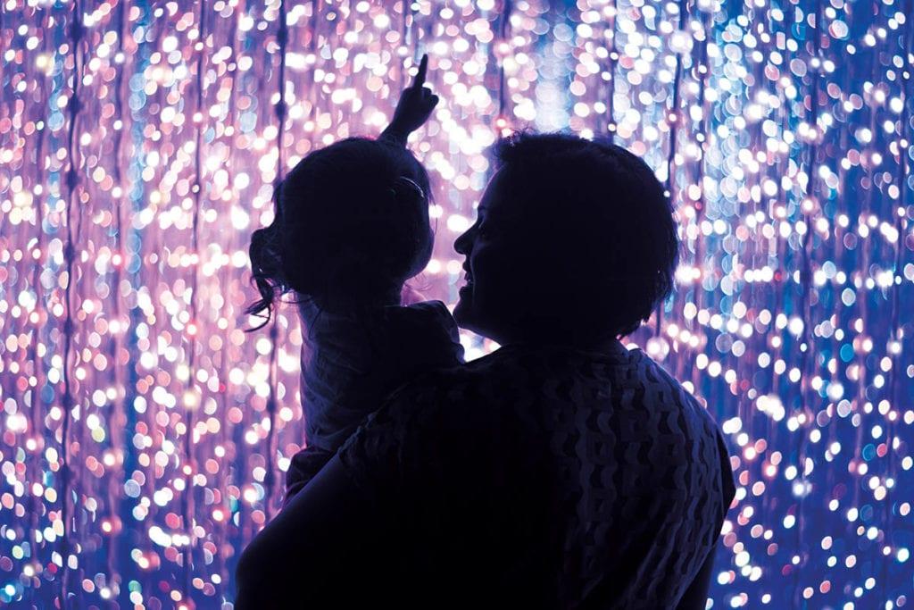 child with parent an lights