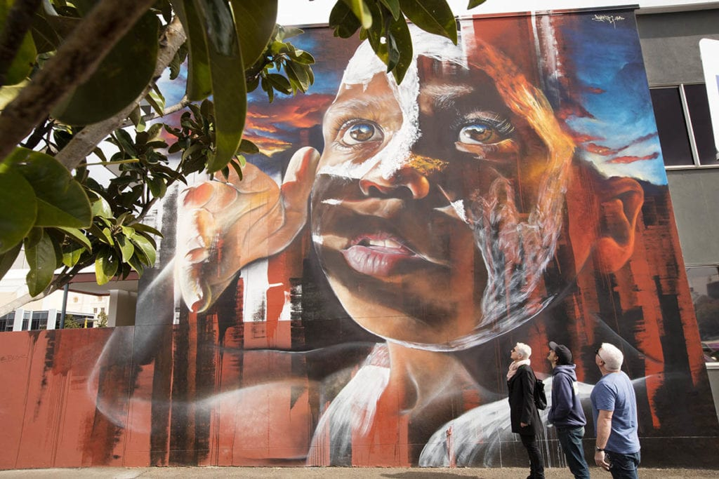 large mural of aboriginal boy